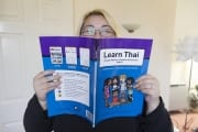 Jess looking in the Learn Thai book (2013)